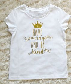 Cinderella inspired Have Courage & Be Kind tee for your girls ----Glittery crown and metallic lettering makes this shirt stand out wherever your little princess goes ----Gold or Silver details ----Other color shirts available upon request! **Please message me with any questions :)