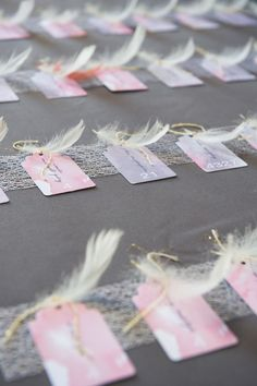 Feather escort cards #wedding | Photography: Twah Dougherty | Style Art Life - www.styleartlife.com Read More: http://www.stylemepretty.com/2014/05/06/garden-glam-hudson-valley-wedding/