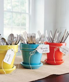 painted flower pots & saucers to hold silverware at a gathering