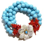 Helga Wagner Stabilized Turquoise Bracelet with Red Coral and Mother of Pearl flower clasp with Turquoise Cabochon set in 14 K gold.