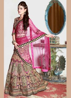 Bring out the true diva in you and reinvent your true self. Add richer looks to your persona in this majestic pink velvet and net a line lehenga choli. The lovely embroidered, cutdana, patch border an...