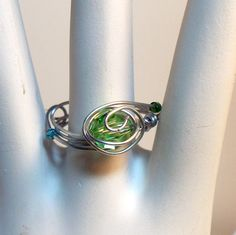 Peridot: thought to bring the wearer good luck, peace, and success. Its powers include health, protection, and sleep. The advantages of peridot are to attract love and calm anger while also soothing nerves and dispelling negative emotions. Peridot has been known to have healing effect on the gall bladder and liver. Peridot is the birthstone for Libra, Pisces, Gemini, Leo, and Virgo.