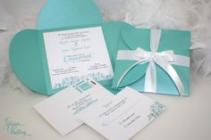 PLEASE READ FULL DESCRIPTION FOR INSTRUCTIONS This is The Anggela a beautiful aqua engagement party invitation. Printed on shimmery white with lovely swirls and an engagement ring with a crystal. All pieces are nested in a beautiful aqua blue pochette and tied with a satin white bow. Set