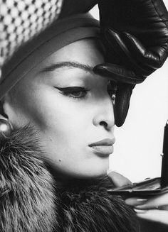 NOW HERE IS A PERFECT CAT EYE!! EYELINER BACK THEN WAS MATTE, WHICH I ACTUALLY LIKE--CLASSIC CHIC!!  Photo by Richard Avedon, September 1962