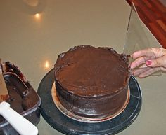 I love using ganache to cover cakes and wedding cakes as it tastes incredibly delicious and it's so much easier to get nice, s...