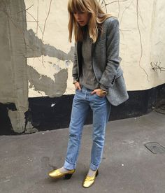 Pernille Teisbaek of Look De Pernille in a patterned blazer, simple top, cuffed jeans, and metallic gold heeled flats
