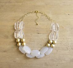 Items similar to Gold Clear and White Statement Necklace, Gold Beaded Necklace, Clear Statement Necklace, Chunky Gold Necklace, Multi Strand Neutral Necklace on Etsy Chunky Gold Necklaces, White Statement Necklaces, Chunky Jewelry, Statement Jewelry, Beaded Jewelry, Jewelry Necklaces, Beaded Bracelets, Gold Jewelry, Diy Necklace
