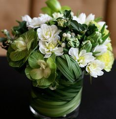 Love these tight arrangements.  Notice the leaves in the vase....
