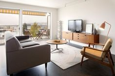 Dark Marmoleum floors/White walls Mid Century Flat Remodel - modern - living room - seattle - SHED Architecture & Design