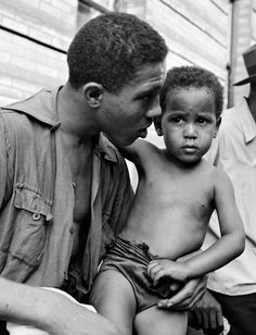 """the–elusive–muse: """" Red Jackson with Child, Harlem, New York, By Gordon Parks. The first story that Parks proposed to Life magazine was a piece on the gang wars that were consuming Harlem in the. Gordon Parks, Jackson, Slider, Harlem Renaissance, African American History, American Women, Native American, Glamour Photography, Vintage Photography"""