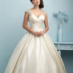 9204 - Designed for the princess, this taffeta ballgown is finished with Swarovski crystal encrusted cap sleeves and V back.