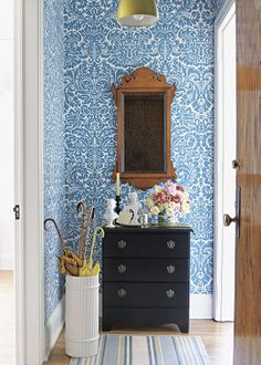 Small Space Solutions: Here, graphic blue-and-white wallpaper adds life to an entry. Crisp white trim balances the space.