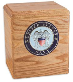Urns Northwest  - The Freedom Urn, $169.00 (http://urnsnw.com/the-freedom-urn/) Oak wood. Made in the USA. Choice of Army, Air Force, Navy, Marine Corps or Fire Department medallion.