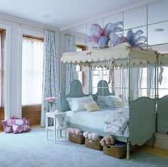 Mirrors make the room look twice as big and adds so much light to such a fun girls room.
