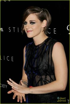 Kristen Stewart shows off a old-fashioned hairdo while hitting the premiere of her latest film Still Alice held at Landmark Sunshine Cinema