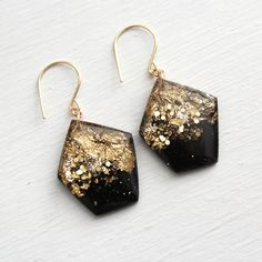 black geometric earrings with gold leaf and by tinygalaxies