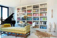 Like the combination of baby grand, built in bookshelves and chandelier (but definitely not the animal skin rug).