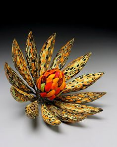 Dream of Wildflower. Leaves from moretti glass, central stamen is porcelain, branches are bronze. Michael Sherrill, NC ceramicist.