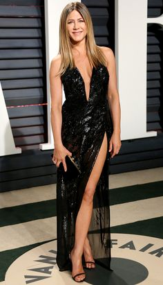 Oscars 2017: Jennifer Aniston wore a black sequin Versace dress with a plunging neckline and a thigh high slit. This is one of Jennifer's best looks! This dress fits her like a glove! Gorgeous sequins!