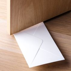 You've Got Mail Door Stopper / This You've Got Mail Door Stopper from Qualy is a clever doorstop that makes it look like there's a letter that's been dropped off for you, and it's peeking out from under the door. http://thegadgetflow.com/portfolio/youve-got-mail-door-stopper/
