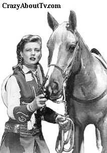 Annie Oakley (Gail Davis)  Annie Oakley was a 30 minute western action series that aired in syndication. It was about a young woman who was 5 feet 2 inches tall and weighed only 95 pounds. Unlike most women of her day, she didn't get married, cook, clean and bear children. Annie could shoot, rope and ride with the best of 'em! Annie Oakley, her little brother Tagg and Sheriff Craig kept their little town of Diablo safe from wandering outlaws.