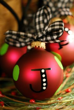 Dimples and Tangles: Personalized Ornaments - they are made with a paint pen, but I would add rhinestones on the dots to bling em out! Awesome!