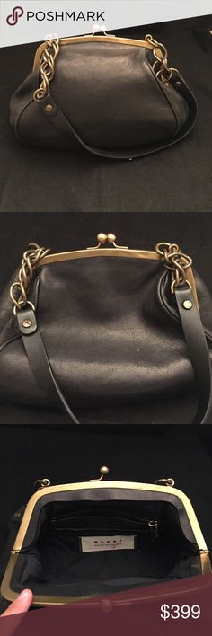 Marni black framed handbag Marni Black leather framed bag. It is a pebble leather with distressed or antiqued gold kiss lock and chain. There is denting on the frame that was always there. Interior is a nylon and is in good condition can be wiped clean. There is a pocket for yourself own a pocket before the zippered pocket so a total of three interior pockets plus main compartment. This is Marnie from the winter edition 2010 there is pen mark on tag as shown. I may have original tag…