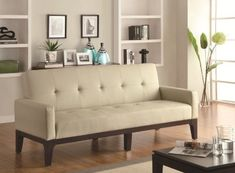 Casual Style Sofa Bed in a Creme Leather Like Vinyl
