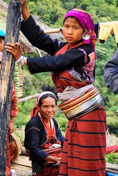 Wearing traditional waist hoops . Shan State . Burma