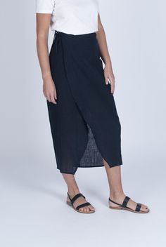 Design features:        * Wrap skirt      * Lightweight navy linen, sourced from a family-run weaver in Kerala &        grown without harmful chemicals      * Organic bamboo silk half-lining in black      * Dyed with non-toxic reactive dye      * Narrow rolled hem      * Three-thread overlock fi