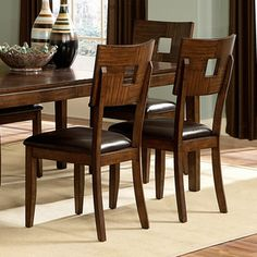 @Overstock.com - Watson Open Back Casual Dining Chairs (Set of 2) - These two beautiful Watson distressed dining chairs are a stylish addition to any dining room. With a distressed amber wood finish and a square cutout on the chair back, these chairs feature black faux leather cushions and turned legs.  http://www.overstock.com/Home-Garden/Watson-Open-Back-Casual-Dining-Chairs-Set-of-2/4750522/product.html?CID=214117 $150.99
