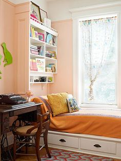 A daybed beside the desk area is pressed into service as a spot to sit while helping kids with homework. Two drawers built into the bed's platform and a shelf overhead provide ample storage for growing needs.