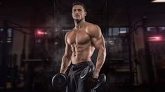 Young Handsome Sportsman Bodybuilder Weightlifter With An Ideal