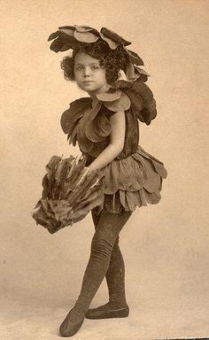 Flower fairy opening an umbrella by lovedaylemon, via Flickr