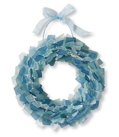 Sea Glass Wreath: Long-lasting tumbled glass will add beauty to your home for years to come $99     Could DIY with a metal frame & hot glue gun!