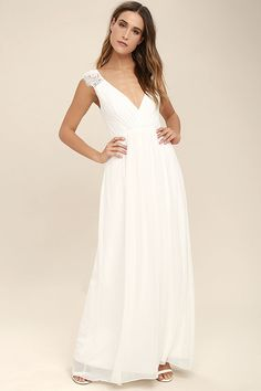You can feel the magic in the air the moment you slip on the Whimsical Wonder White Lace Maxi Dress! Lightweight chiffon shapes a pleated surplice bodice with lace straps. Fitted waist leads into a cascading maxi skirt. Hidden back zipper.