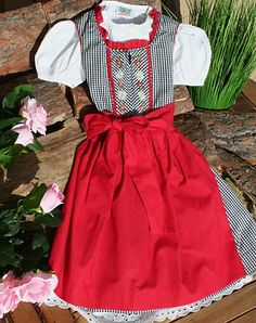 My Opa used to bring me a drindl dress just like this each time he came back from a visit to Germany.