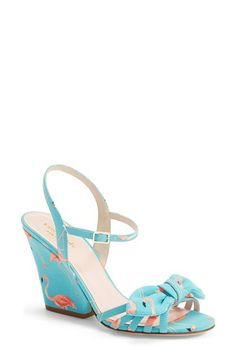 "Free shipping and returns on kate spade new york kate spade 'indie' wedge sandal (Women) at Nordstrom.com. <p><B STYLE=""COLOR:#990000"">Pre-order this style today! Add to Shopping Bag to view approximate ship date. You'll be charged only when your item ships.</b></p><br>With its feminine knotted bow and playful flamingo print, this flirty wedge sandal will have you strutting the boardwalk in style."