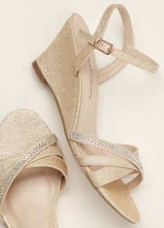 Add a subtle dose of spakle to any ensemble with these rhinestone embellished wedge sandals!  Low wedge sandal features glistening rhinestone embellishments across one of the toe straps.  Heel Height: 2 inches. Available in sizes 5.5-9, 10.  Imported.