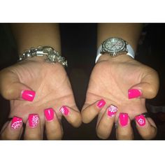 Hot pink nails with dotting tool designs