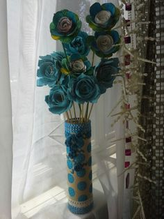 Candel Base with Egg Carton Flowers. Cool blue color.