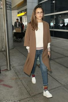 Jessica Alba wearing Vince Warren Leather Sneakers, Amo Babe Jeans in Dive Bar and Tod's Wave Bag in Pink