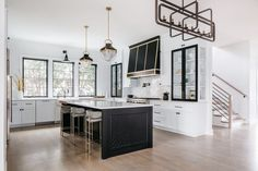 black and white home kitchen with black island, glass cabinets, white cupboards, and brass accents. Natural Oak Flooring, Kitchen Trends, Kitchen Ideas, Kitchen Inspiration, Kitchen Designs, Cocinas Kitchen, Bars For Home, Cool Kitchens, New Homes