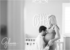 On Location: In home Maternity Session - Newport Beach Photographer, Newport, CA, Cali, California, new home, pregnant, maternity, sky blue dress, maxi dress, pregnant belly, beautiful couple, neutral tones, neutral colors, blonde, red nail polish, manicure, husband kissing belly, nursery, initials, smiling, focused, blurred, black and white edit, B&W photo  GilmoreStudios.com