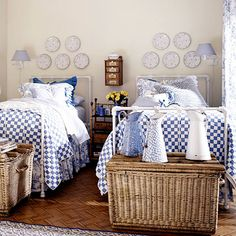 A pretty palette of blue and white carries through to a collection of French enamel milk pitchers and a series of French pottery plates hung above the beds. French laundry baskets hold extra linens at the end of each bed. by samanthasam French Country Interiors, Country Interior Design, French Country Bedrooms, French Country Style, French Country Decorating, Country Blue, Country Bathrooms, Cottage Decorating, Decorating Ideas