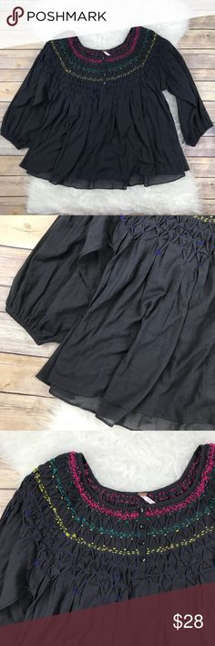 """Free People Smocked Babydoll Blouse Excellent condition Free People Smocked Babydoll Blouse. Size Medium. Dark blue gray with Smocked yoke accented with bright colors. 100% cotton, slightly sheer. Bust 40"""", length 24"""", 3/4 sleeves with elastic cuffs. No trades, offers welcome. Free People Tops Blouses"""