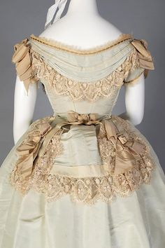 1872. A young woman's dress, I suspect, given the then-retro emphasis on the sloping shoulders.
