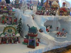 custom foam Dept 56 christmas village displays on etsy. Oh man, do I wish I could afford a piece from her for my village!