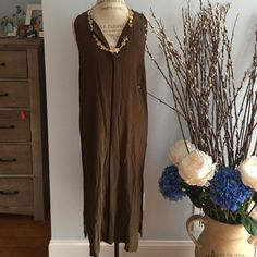 NEVER WORN OLIVE GREEN STRAIGHT DRESS W/LOW SLIT Never worn olive color with black trim dress size is xsmall but fits small too. MIDI length. Measurements: shoulder to shoulder: shoulder to bottom: pit to pit: Dresses Midi