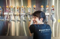 A happy tapster at Right Brain Brewery in Traverse City's SoFo District.